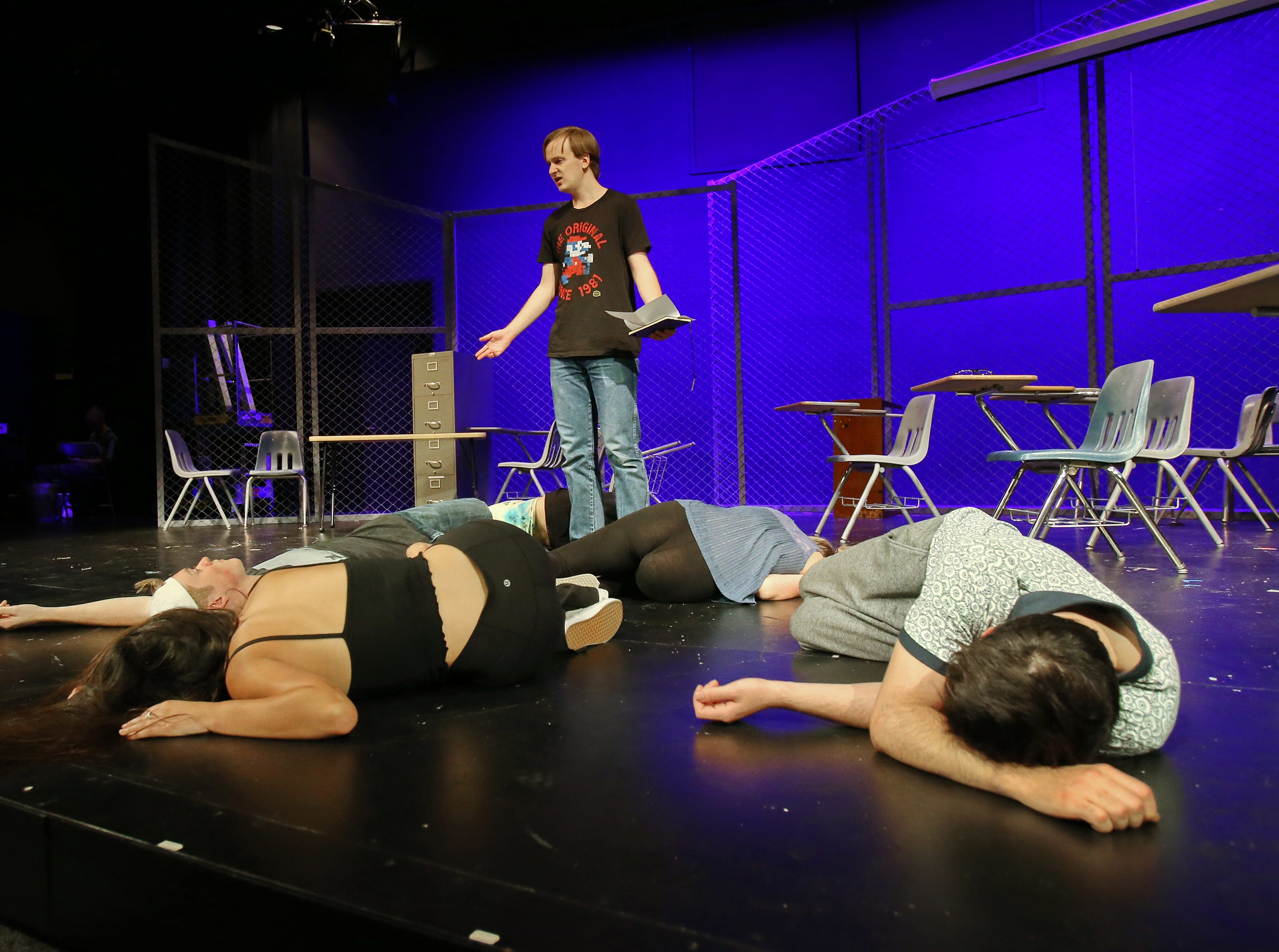 """Jacob White stands among his fallen cast members in California Lutheran University's production of """"Columbinus,"""" which is based on the 1999 shooting at Columbine High School in Littleton, Colorado. White plays the role of shooter Dylan Klebold. The shooting, which claimed the lives of 15 people, was the deadliest school shooting in the United States at the time."""