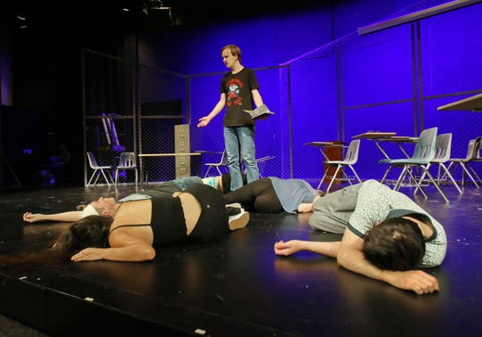 "Jacob White stands among his fallen cast members in California Lutheran University's production of ""Columbinus,"" which is based on the 1999 shooting at Columbine High School in Littleton, Colorado. White plays the role of shooter Dylan Klebold. The shooting, which claimed the lives of 15 people, was the deadliest school shooting in the United States at the time."