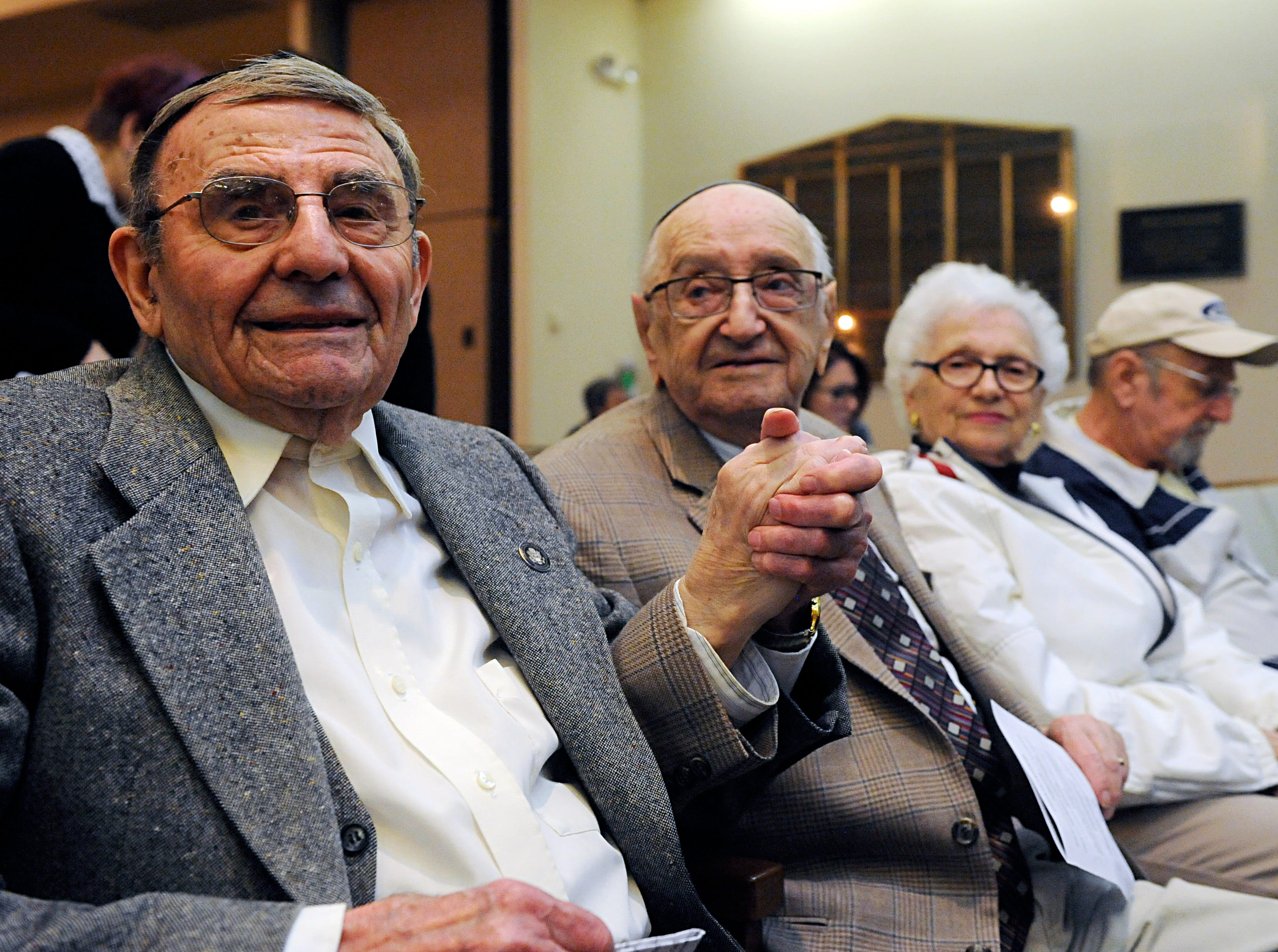 Holocaust survivors Izzy Randel and Murray Ressler clasp hands at Beth Israel Congregation in Vineland in honor of their six decade friendship.