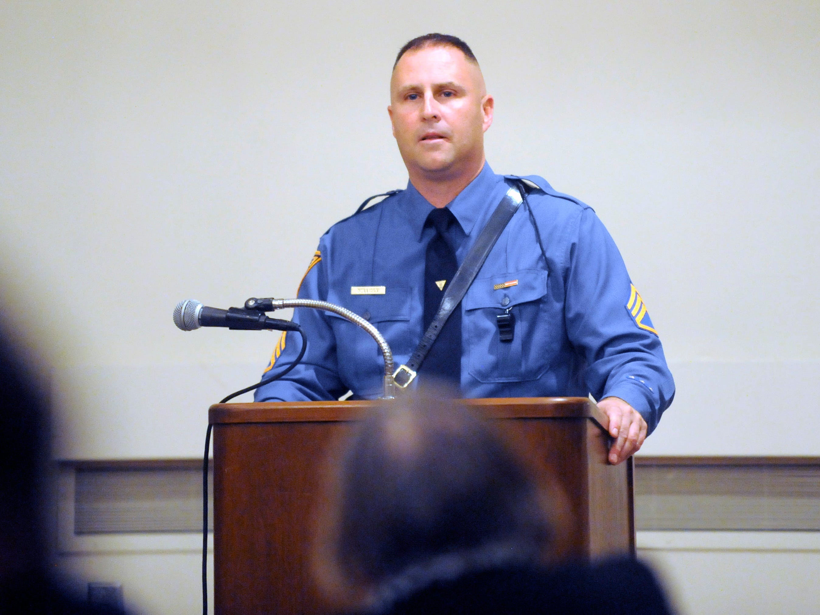 N.J. State Police Staff Sgt. Brian Elliott speaks during a house of worship safety workshop following Thursday's vigil at Beth Israel Congregation.