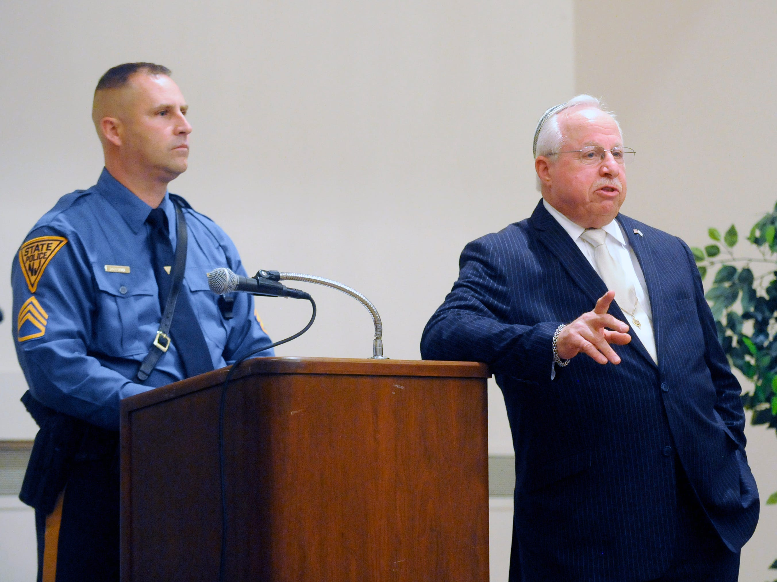 M. Jay Einstein (right) and N.J. State Police Staff Sgt. Brian Elliott speak during a house of worship safety workshop following Thursday's vigil at Beth Israel Congregation.