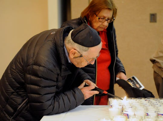 Holocaust survivor Jacques Brunner, 93 of Millville, lights a candle at Beth Israel Congregation in Vineland in honor of the Tree of Life Synagogue victims.