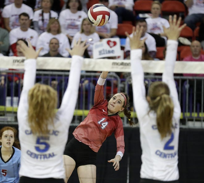 Newman Catholic's Lauren Shields hits against Catholic Central in a Division 4 semifinal during the WIAA state girls volleyball tournament Friday at the Resch Center.