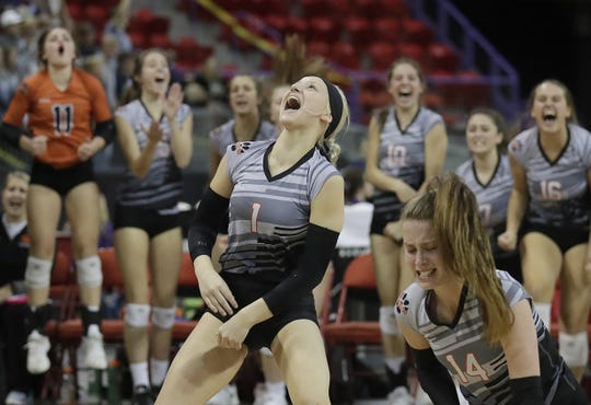 Stratford's Taylor Wussow celebrates an opening-set win against Living Word Lutheran during the WIAA Division 3 state girls volleyball tournament Friday.