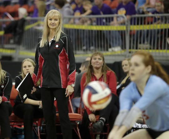 Newman Catholic coach Betty Lange watches libero Grace Ende make a play on a ball during a Division 4 state semifinal matchup with Catholic Central during the WIAA state girls volleyball tournament Friday at the Resch Center.