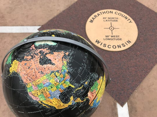 A globe sits at 45 degrees north latitude by 90 degrees west longitude.