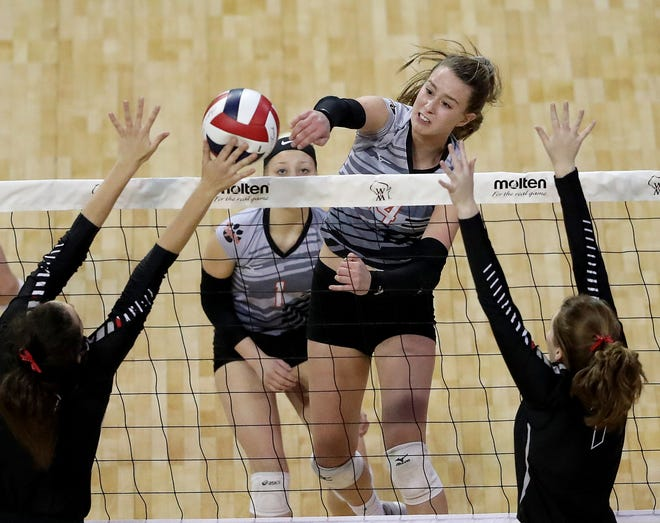 Stratford's Mazie Nagel hits into a block against Living Word in a Division 3 semifinal at the WIAA state girls volleyball tournament Friday at the Resch Center in Ashwaubenon. Nagel led the way with 23 kills and 16 digs for the Tigers.