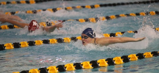 Ursuline's Josephine Panitz, right, swimming the butterfly wins ther 200-yard indivdual medley with a during the Section 1 girls swimming championships at Felix Festa Middle School in West Nyack on Thursday, November 1, 2018.