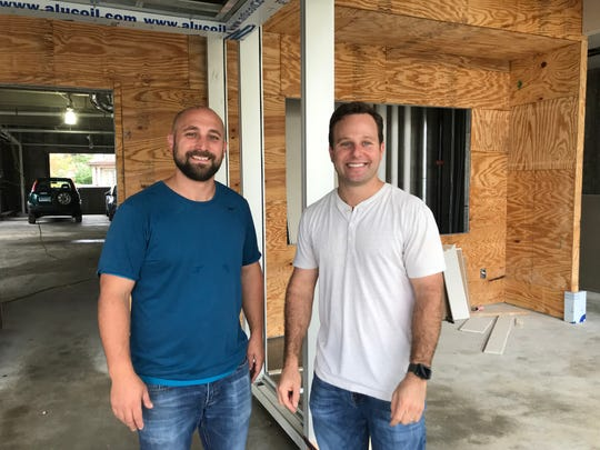 David Mann, president of Lighthouse Living, right, with Rob Madia, project manager of the company at its development, One Dekalb, in White Plains.