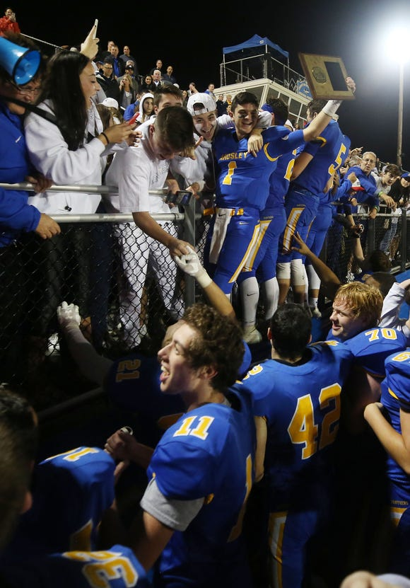 Ardsley players celebrate with their fans  after defeating Putnam Valley 35-0 in the Section 1 Class B championship game at Mahopac High School Nov. 2,  2018.