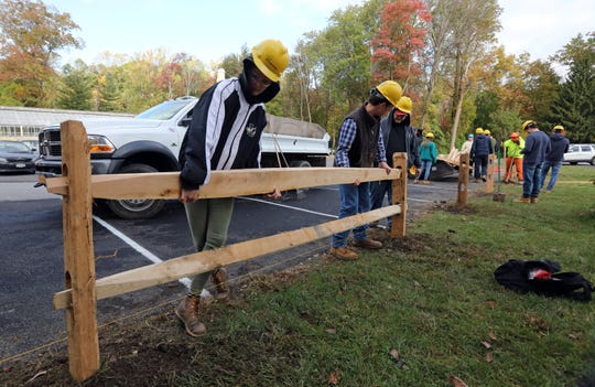 Putnam Northern Westchester BOCES students Lynzze Grispin, 18, left, and Thomas Connelly, 17, both of south Salem, install post and rail fencing at Caramoor Center for Music and the Arts in Katonah as part of their Urban Forestry and Landscaping Services program Oct. 24, 2018.