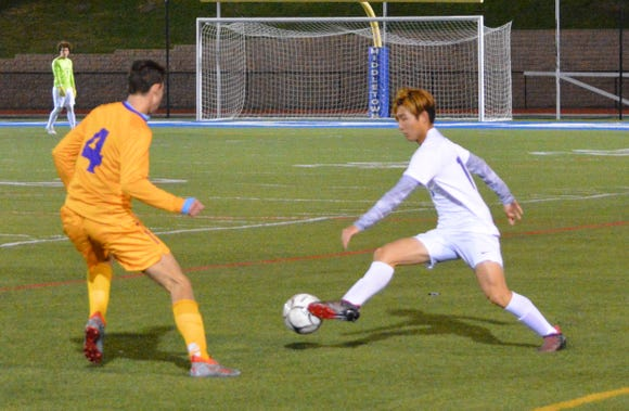 Matt Li pushes (right) the ball in transition for Briarcliff during the first half of Thursday's NYSPHSAA regional semifinal.