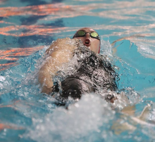 North Rockland's Lauren Aylmer swims the 100-yard backstroke with a 55.63 time at the Section 1 girls swimming championships at Felix Festa Middle School in West Nyack on Thursday, November 1, 2018.