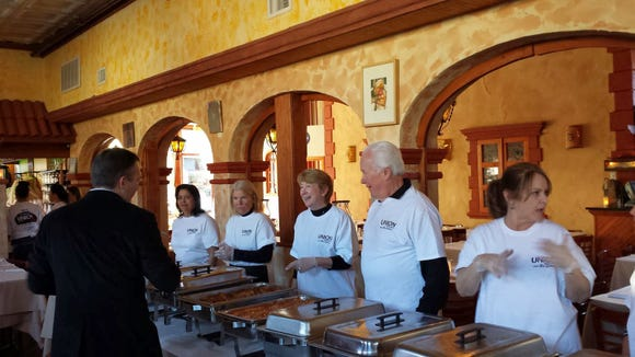 """""""Marina Gutierrez, left, serves free meals at UNION Restaurant's annual """"we care"""" event in Haverstraw."""