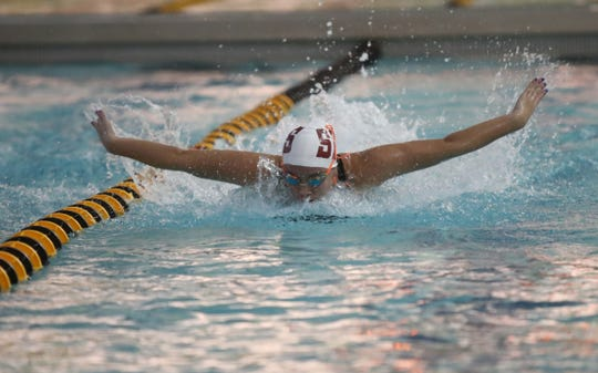 Scarsdale's Joy Jiang swims the 100-yard butterfly during the Section 1 girls swimming championships at Felix Festa Middle School in West Nyack on Thursday, November 1, 2018.  Jiang finished first with a 56.05 time.