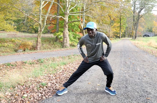 Elite runner Harbert Okuti of Sleepy Hollow stretches while training at Rockefeller State Park Preserve Nov. 1, 2018. Okuti is preparing for his 4th New York City Marathon and 8th in total. Okuti, 33, came to the United States from Uganda in 2005 when he was recruited by Iona College.