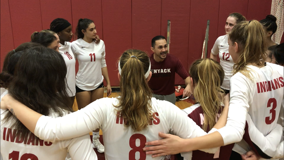Nyack head coach Christian Collazo talks with his team after sweeping John Jay-Cross River and securing the program's first-ever Section 1 finals berth. Nov. 1, 2018.