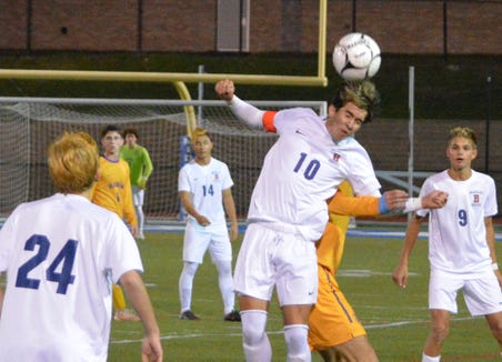 Briarcliff's Alex Cabeca wins a ball at midfield during the second half of Thursday's regional victory by the Bears.