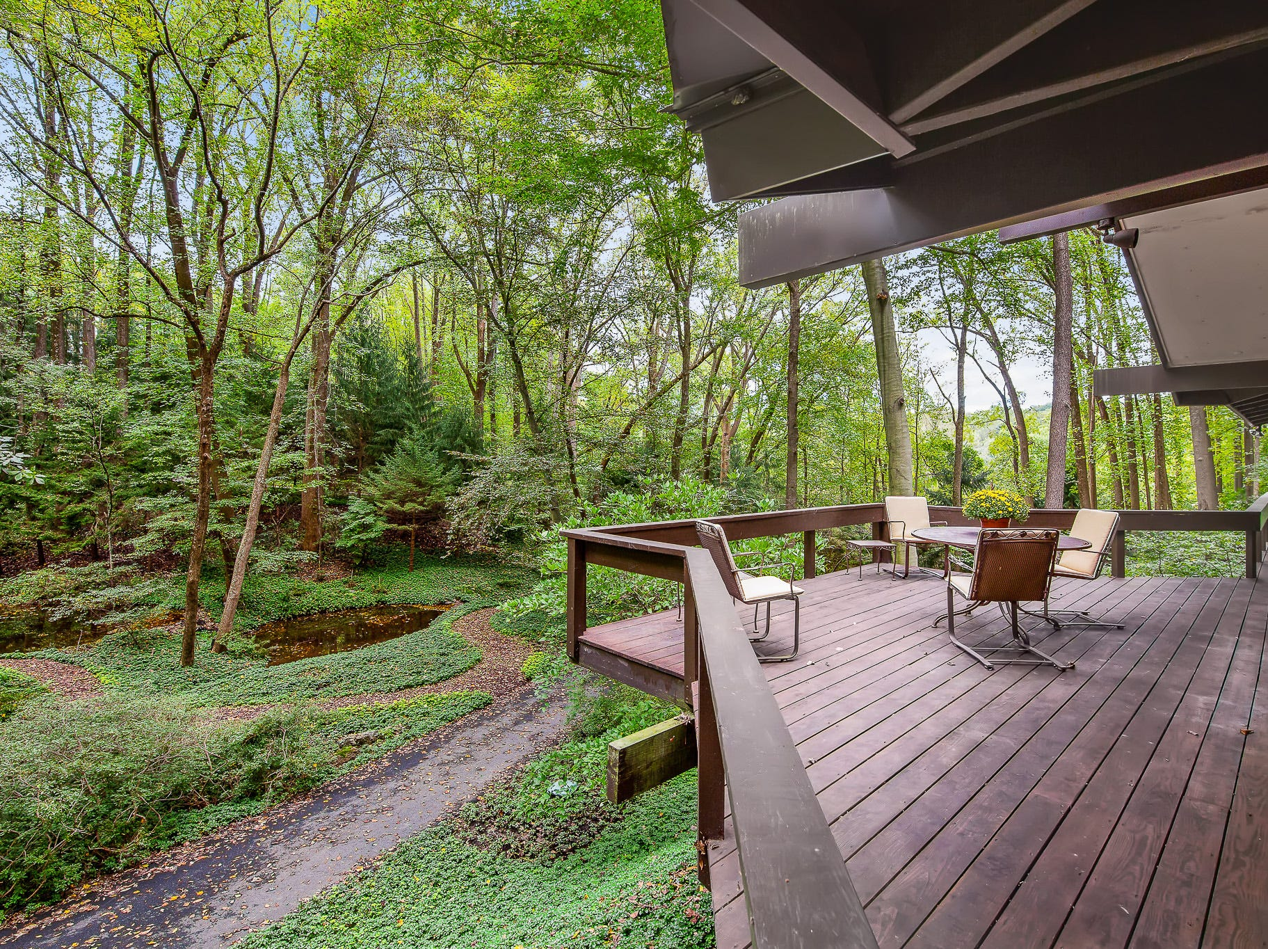 the deck that wraps around 110 Thissell in Greenville turns it into your own private tree house.