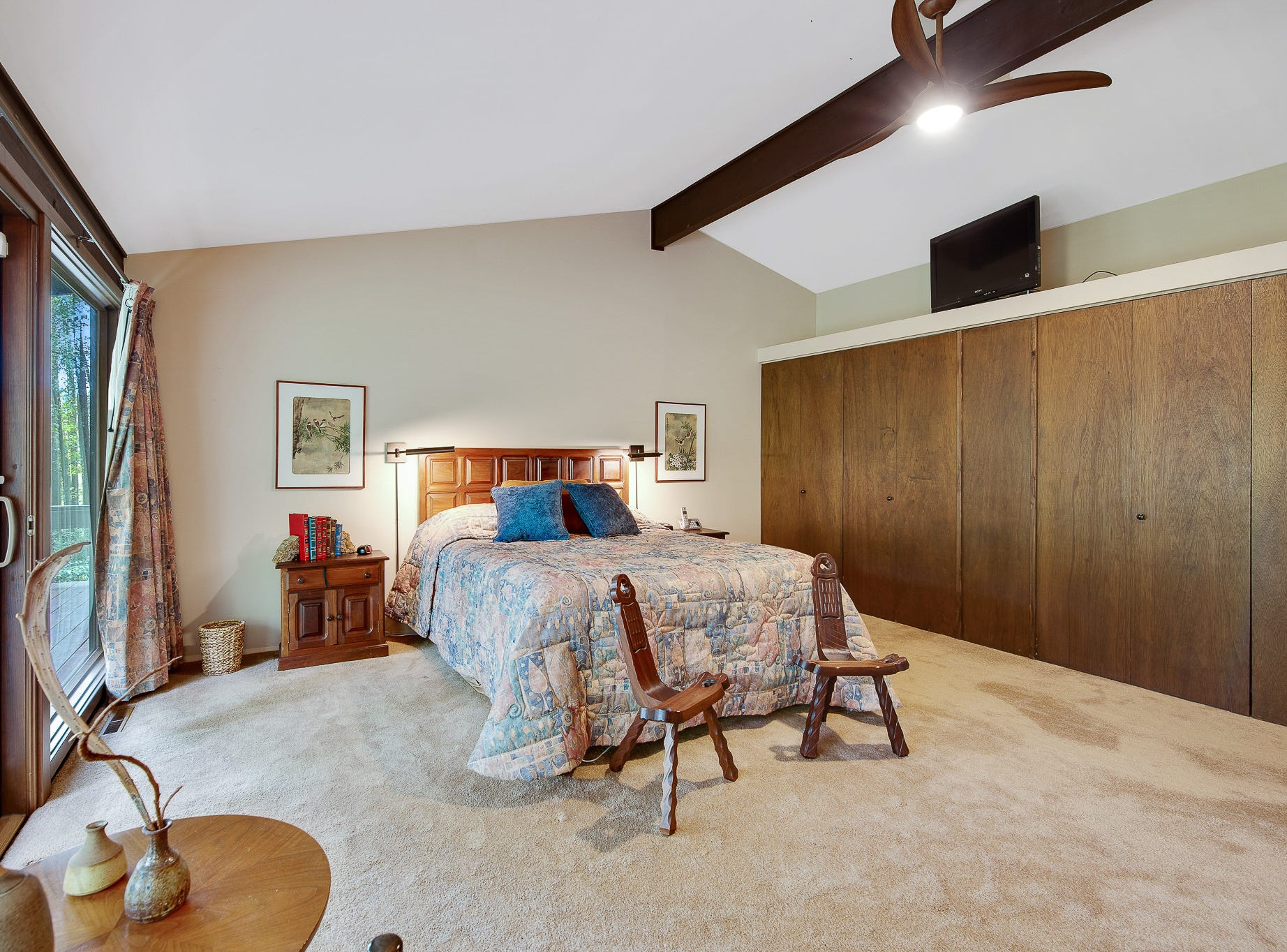 The master bedroom at 110 Thissell in Greenville features beautiful views and built-in closets.