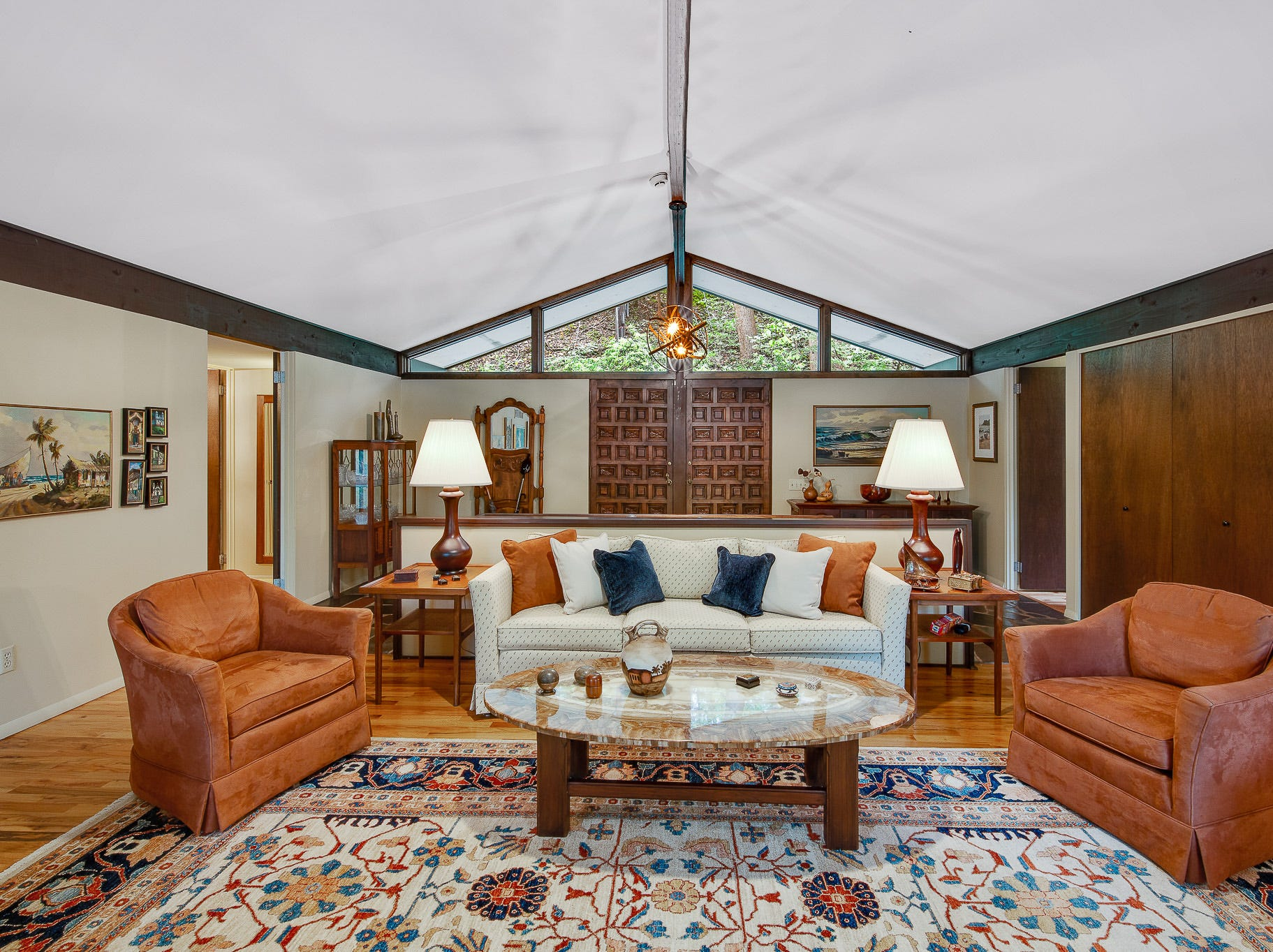 The carved wood doors from Spain open into the vaulted living area at 110 Thissell in Greenville.