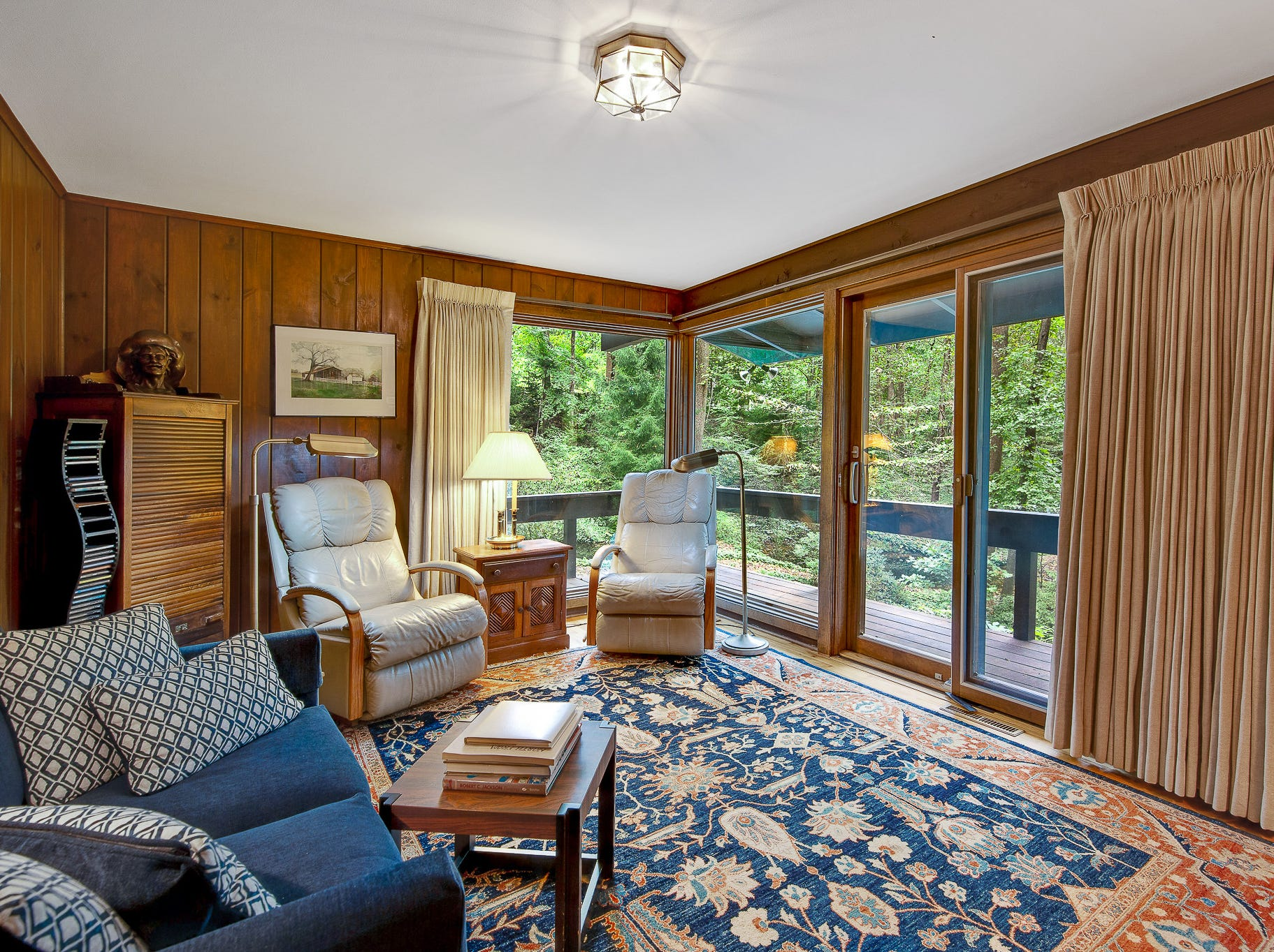 A den at 110 Thissell in Greenville retains the original wood paneling that helps it melt into the scenery.