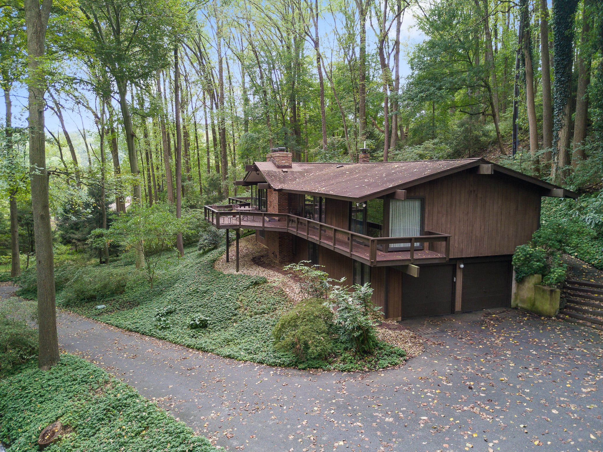 A deck wraps around the mid-century modern home at 110 Thissell in Greenville, which includes a two-car garage.