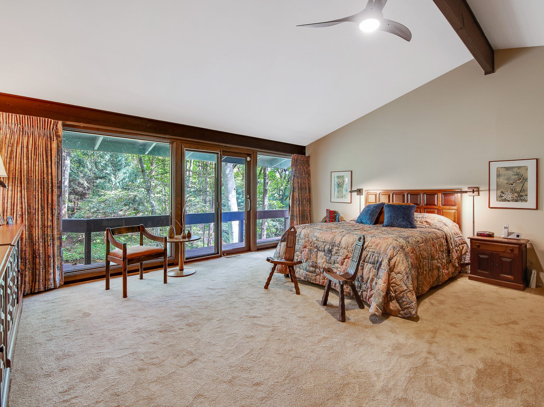 The master bedroom at 110 Thissell in Greenville offers views of greenery.