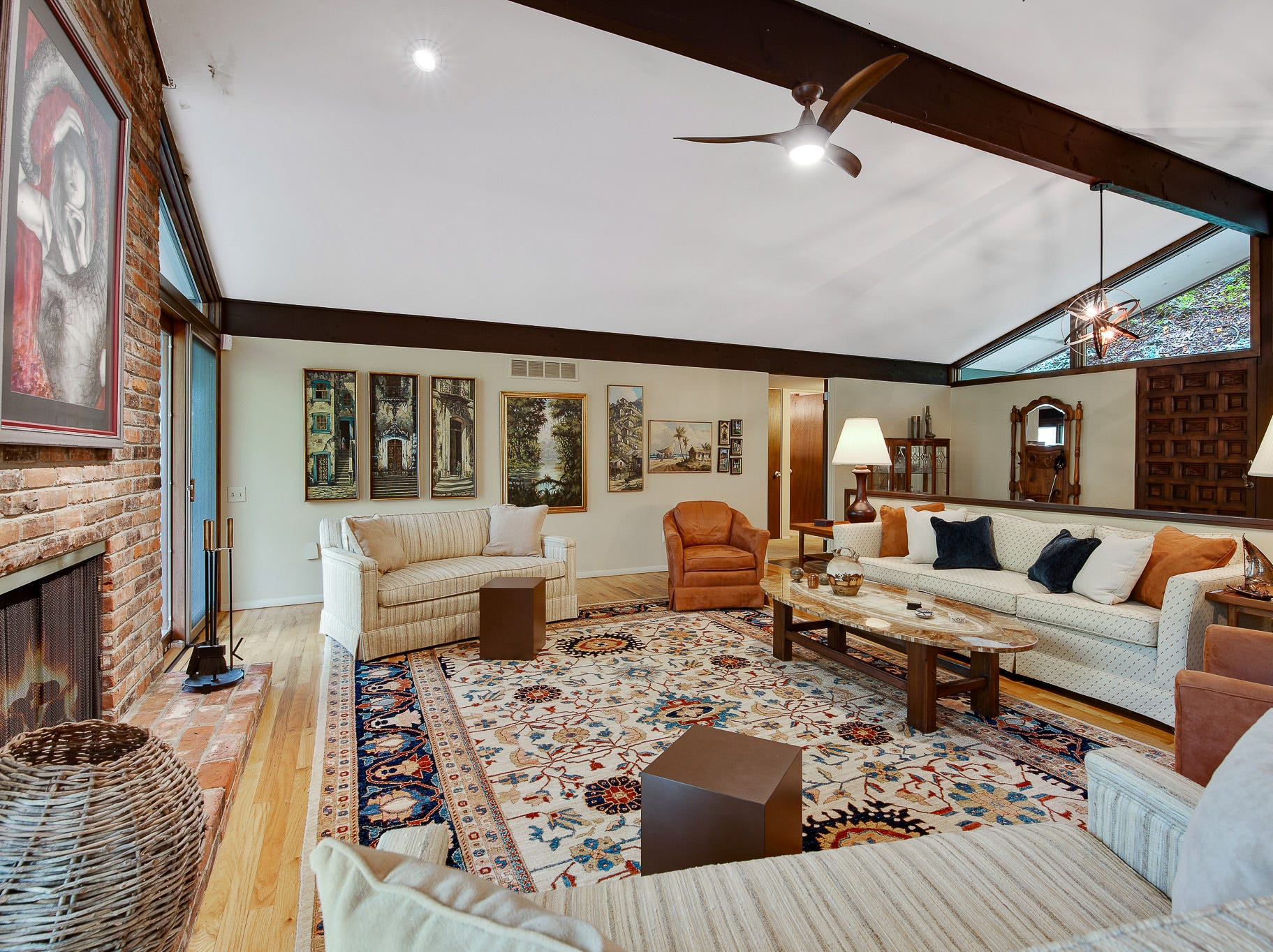 The open living area at 110 Thissell in Greenville has a pitched ceiling and wood moldings.