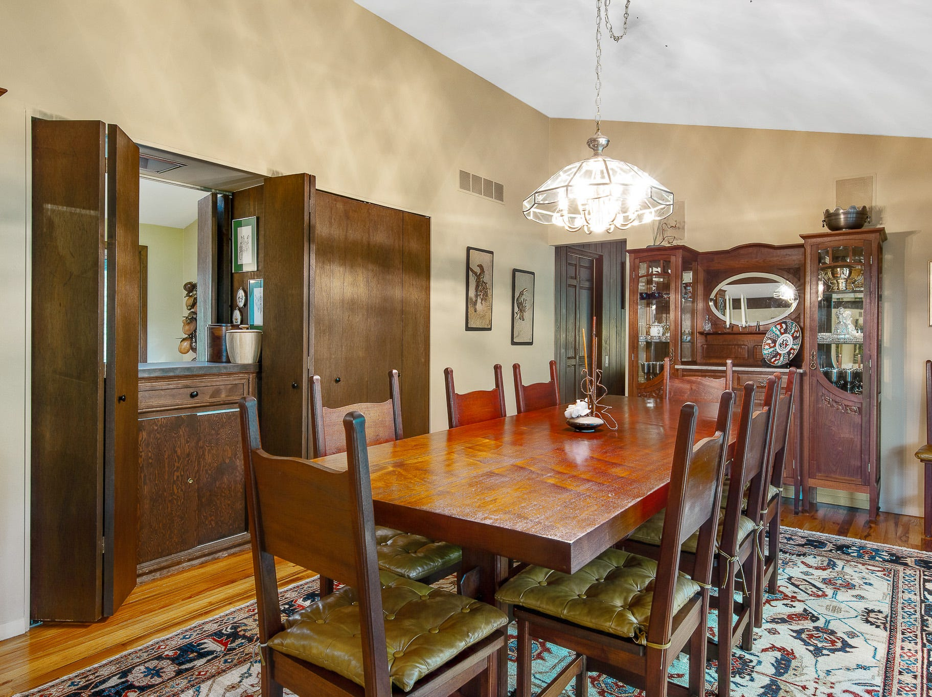 A wet bar opens to both the formal dining and informal dining rooms at 110 Thissell in Greenville.