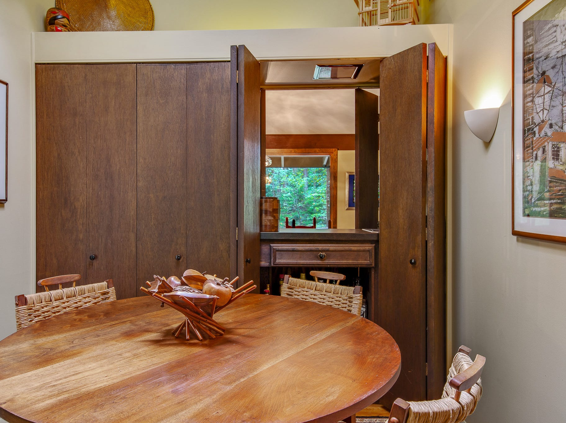 A wet bar connects the formal dining space, and the informal at 110 Thissell in Greenville.
