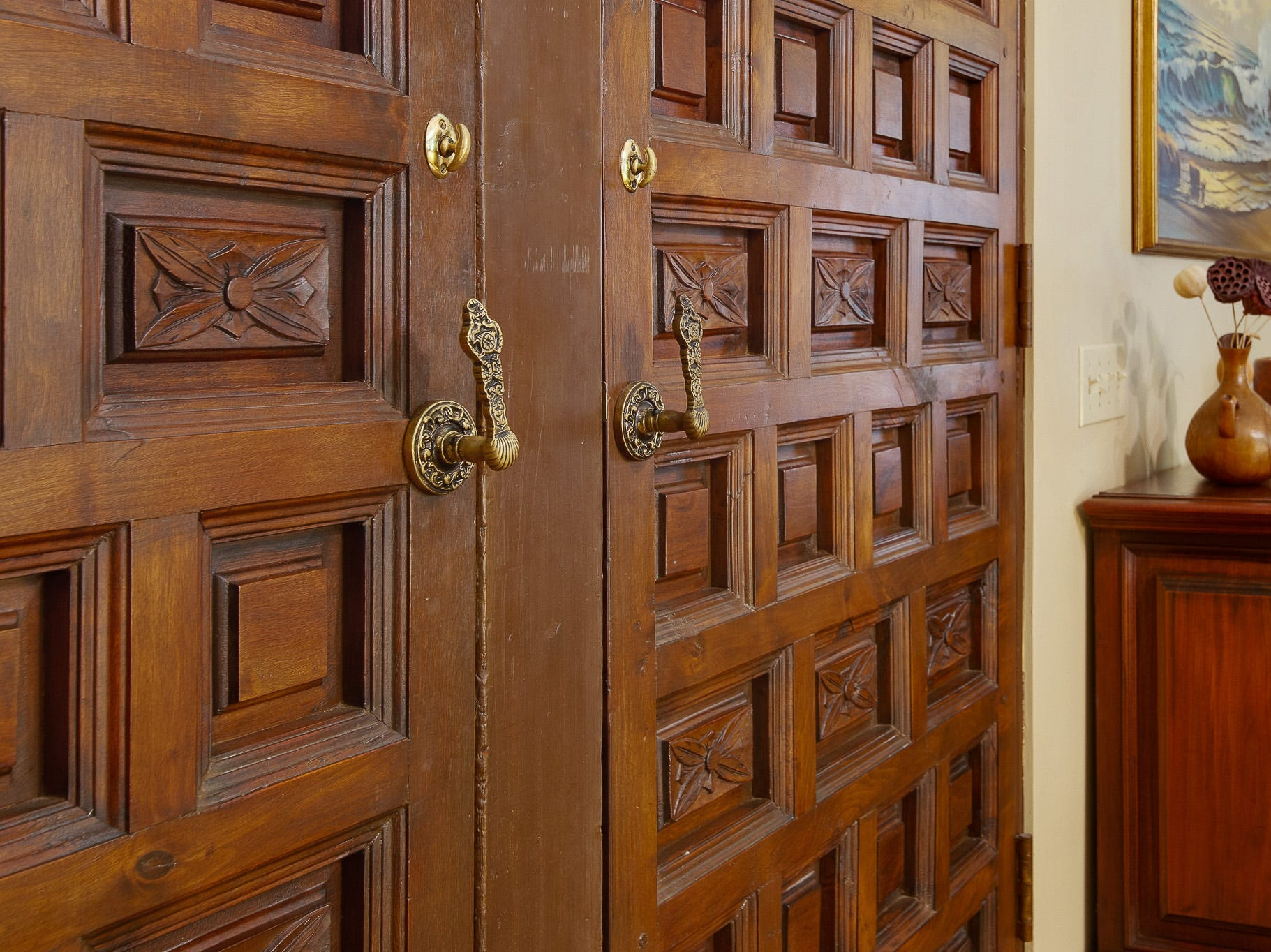 The massive front doors at 110 Thissell in Greenville were custom-made in Spain.