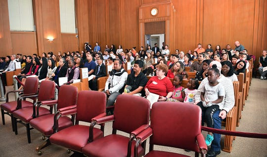 Forty applicants and their friends and families filled the Federal Court during a large Naturalization Ceremony in the U.S. District Court, Northern District of Texas, Wichita Falls Division Friday.