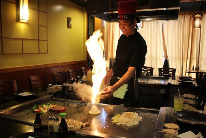 Chef Arif Mulyana prepares an onion volcano at Ichiban Japanese Steak House in Zanesville.