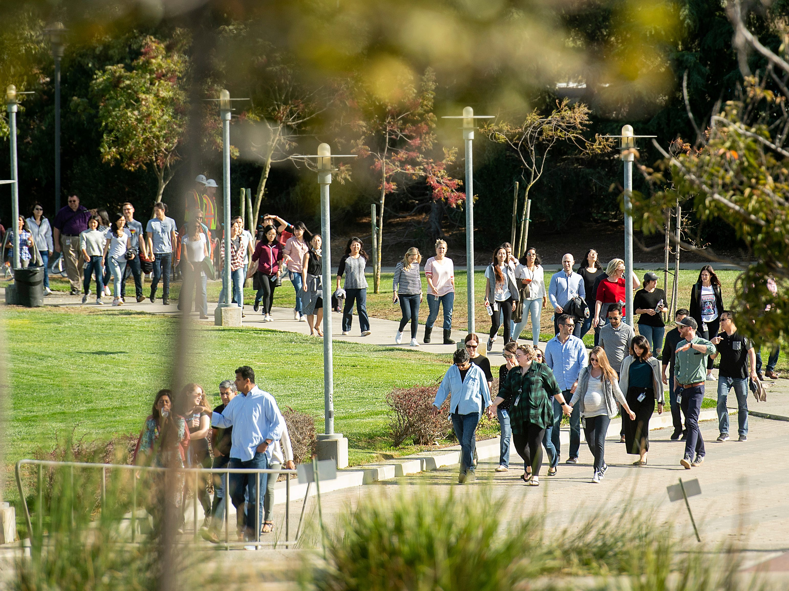People walk towards Google's Mountain View, Calif., headquarters on Nov. 1, 2018.