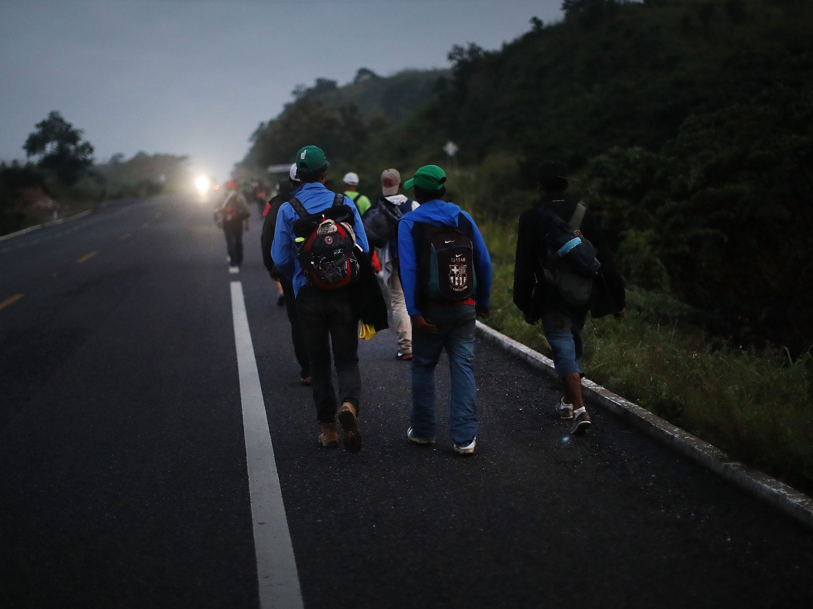 Members of the Central American migrant caravan move to the next town at dawn on Nov. 02, 2018 in Matias Romero, Mexico.