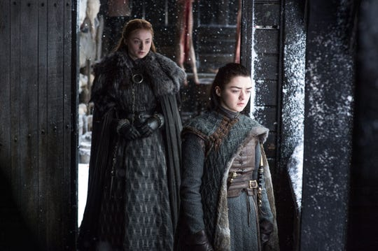 Sansa (Sophie Turner), left, and Arya (Maisie Williams) are sisters in the noble Stark family on HBO's 'Game of Thrones.'