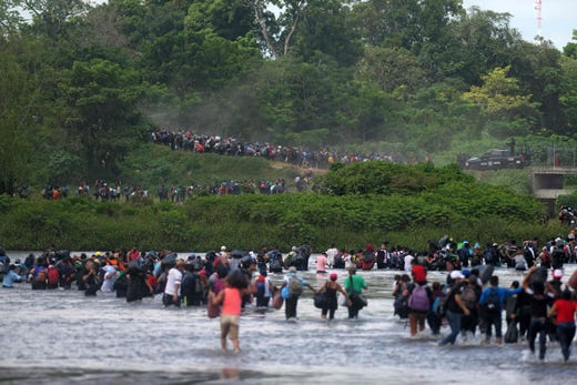 Salvadorian migrants heading in a caravan to the US, cross the Suchiate River to Mexico, as seen from Ciudad Tecun Uman, Guatemala, on Nov. 02, 2018. According to the Salvadorian General Migration Directorate, over 1,700 Salvadorians left the country in two caravans and entered Guatemala Wednesday, in an attempt to reach the US.