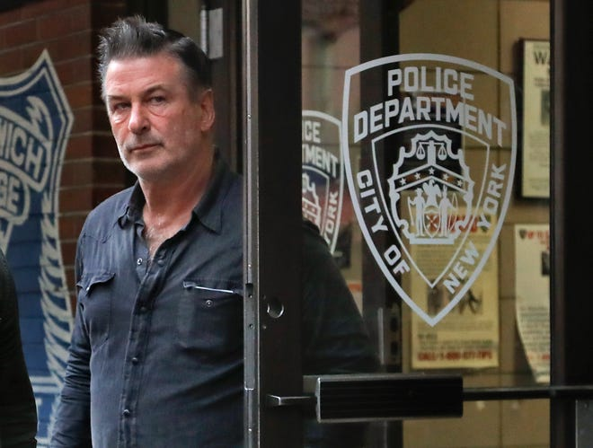 Alec Baldwin walks out of the New York Police Department's 10th Precinct,  Nov. 2, 2018, , after he was arrested and charged with allegedly punching a man in a dispute over a parking spot.