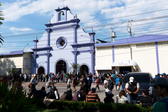 About 500 migrants lined the plaza of Tecun Uman, Guatamala. Some were waiting for a much larger group to arrive Thursday or Friday. Others said they didn't want to wait and planned to cross at 4 p.m. Thursday.
