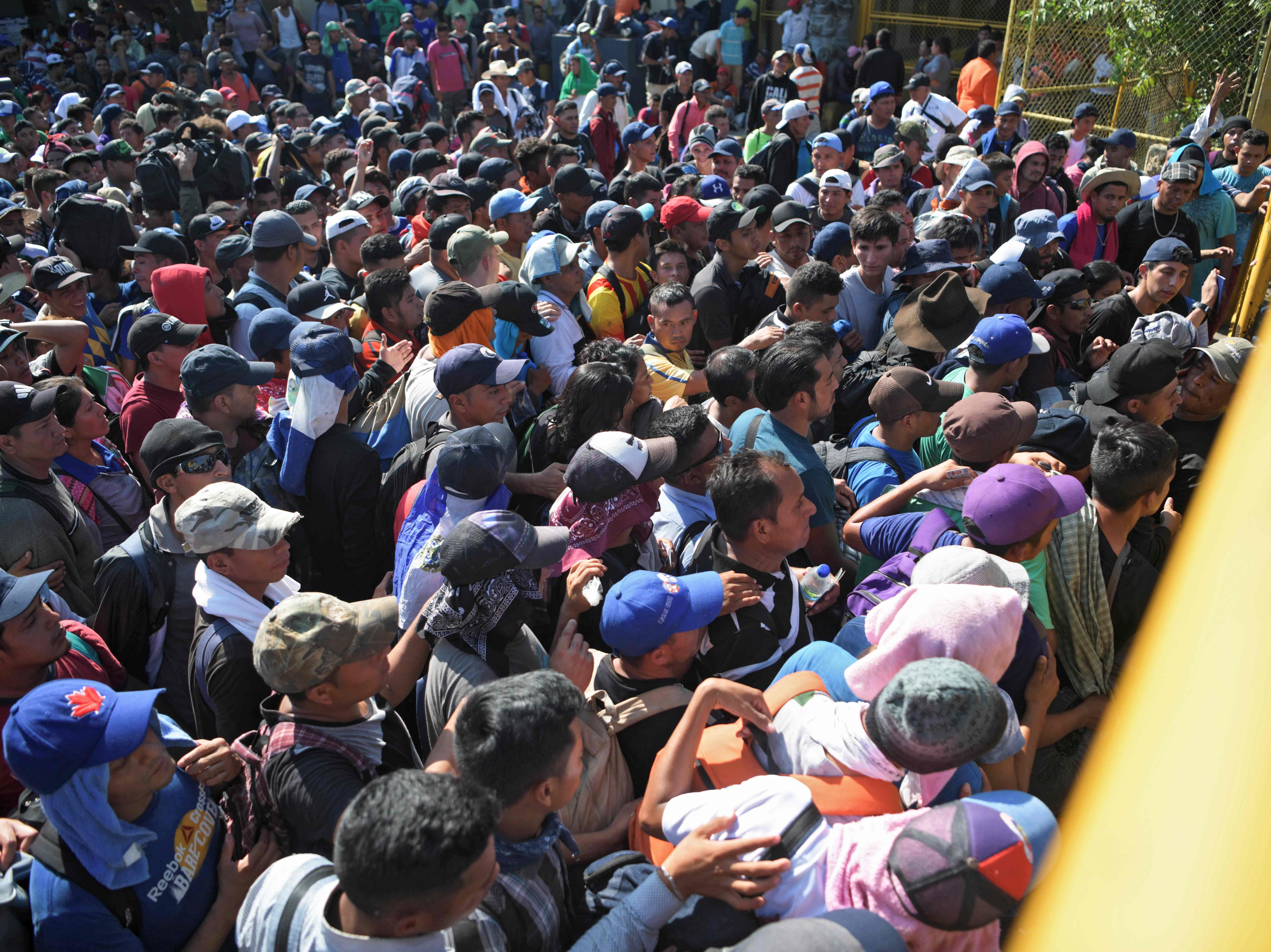 Salvadorian migrants wait to enter the Guatemala-Mexico international border bridge in Ciudad Tecun Uman, Guatemala, on Nov. 2, 2018.