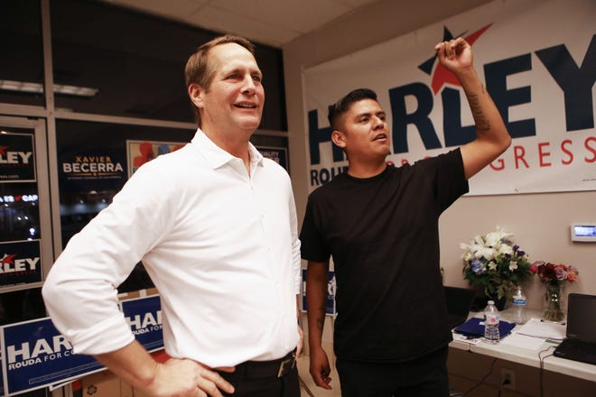 Democratic Congressional candidate Harley Rouda (CA-48), left, greets supporters at a Latinx campaign canvass launch on November 1, 2018 in Costa Mesa, California. Rouda is competing for the seat against Republican incumbent Rep. Dana Rohrabacher. Democrats are targeting at least six congressional seats in California, currently held by Republicans, where Hillary Clinton won in the 2016 presidential election. These districts have become the centerpiece of their strategy to flip the House and represent more than one-fourth of the 23 seats needed for the Democrats to take control of the chamber in the November 6 midterm elections.