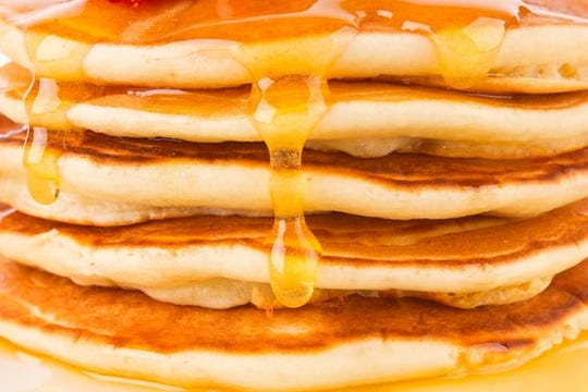 Texture of fresh pancakes with fragrant maple syrup and honey.