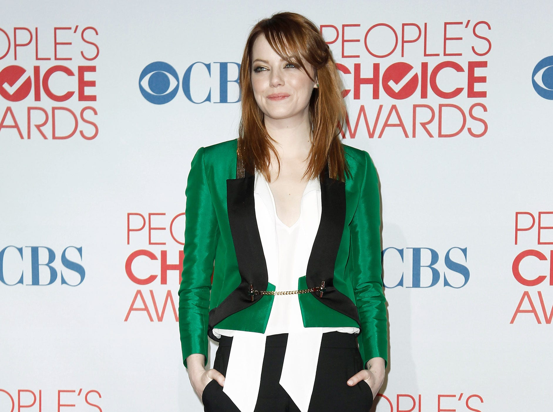 ORG XMIT: OTK Emma Stone, winner of the award for favorite movie actress, poses backstage at the People's Choice Awards on Wednesday, Jan. 11, 2012 in Los Angeles. (AP Photo/Matt Sayles)