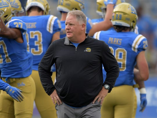 UCLA coach Chip Kelly looks on before his team's game against Washington at the Rose Bowl.