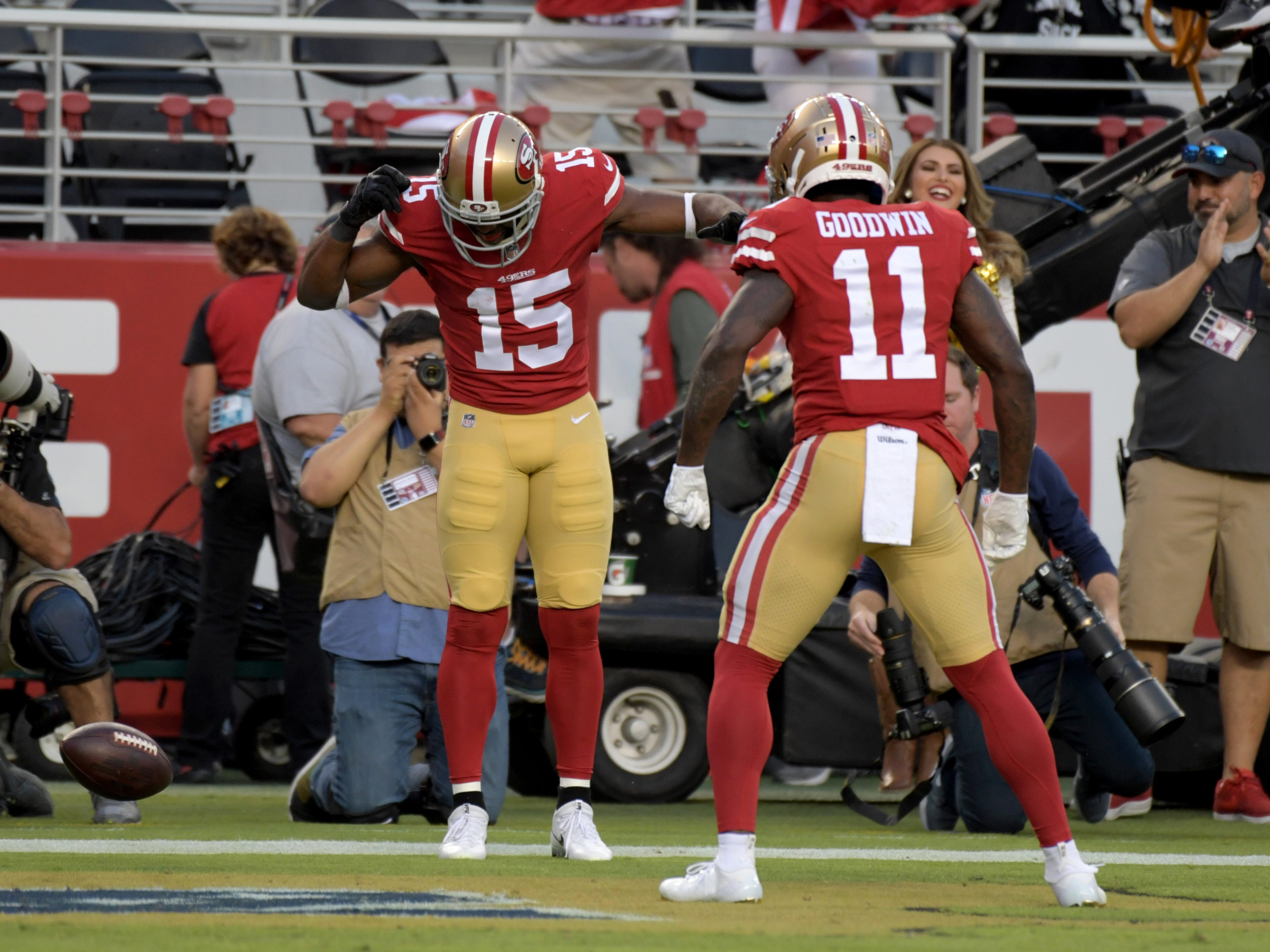San Francisco 49ers wide receiver Pierre Garcon (15) is congratulated by wide receiver Marquise Goodwin (11) after scoring a touchdown against the Oakland Raiders during the half at Levi's Stadium.