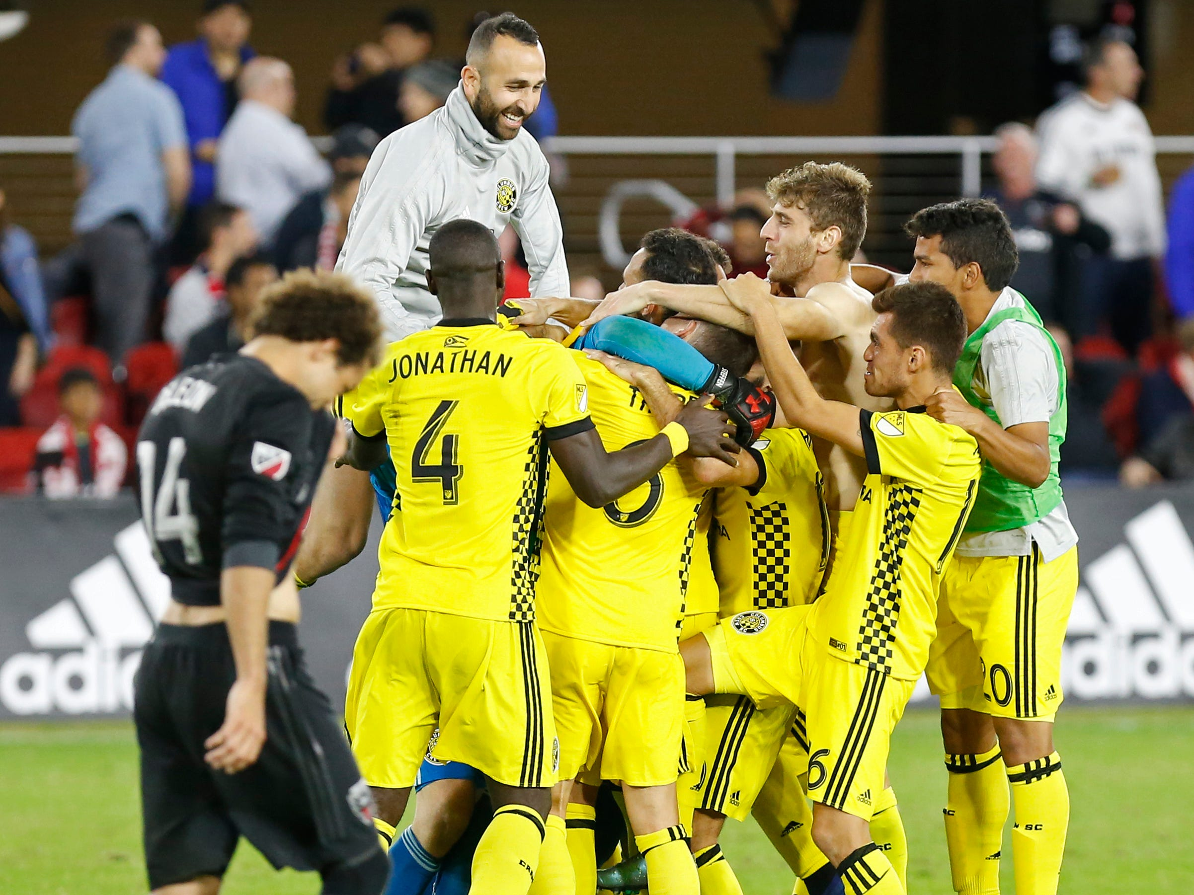 Columbus Crew players celebrate their playoff win over D.C. United at Audi Field.