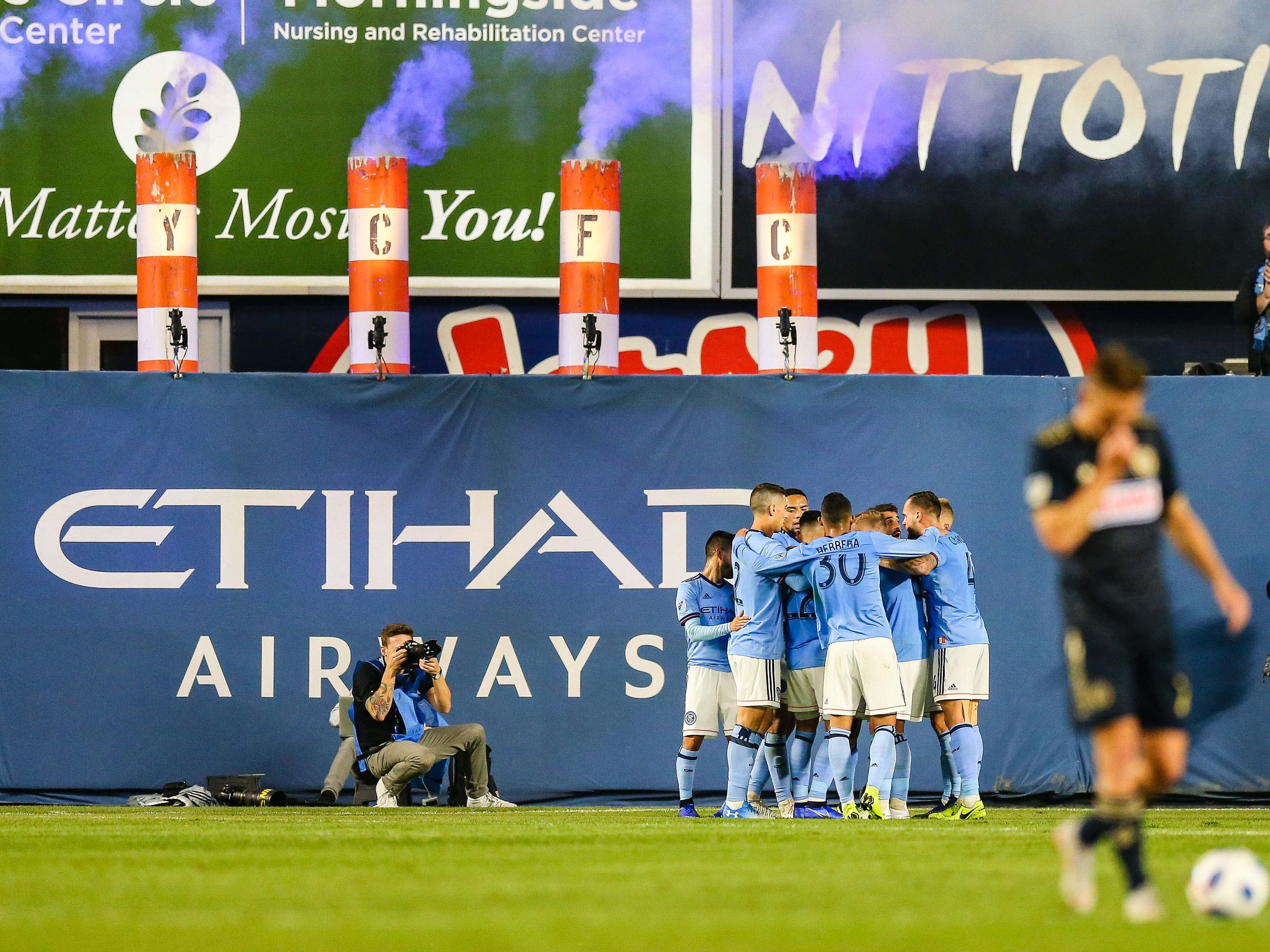 New York City FC players celebrate a goal by David Villa against the Philadelphia Union during the first half at Yankee Stadium.
