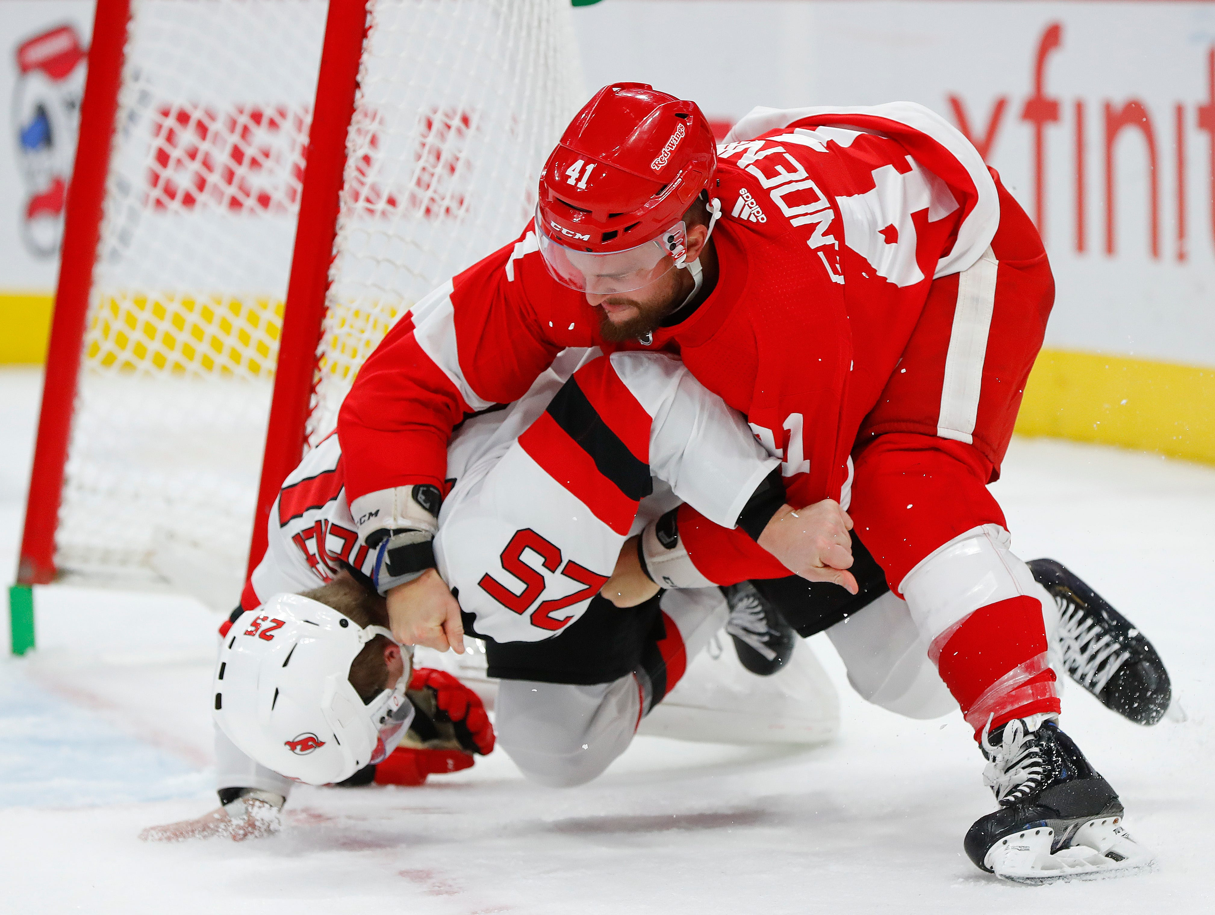 Nov. 1: New Jersey Devils' Mirco Mueller vs. Detroit Red Wings' Luke Glendening.