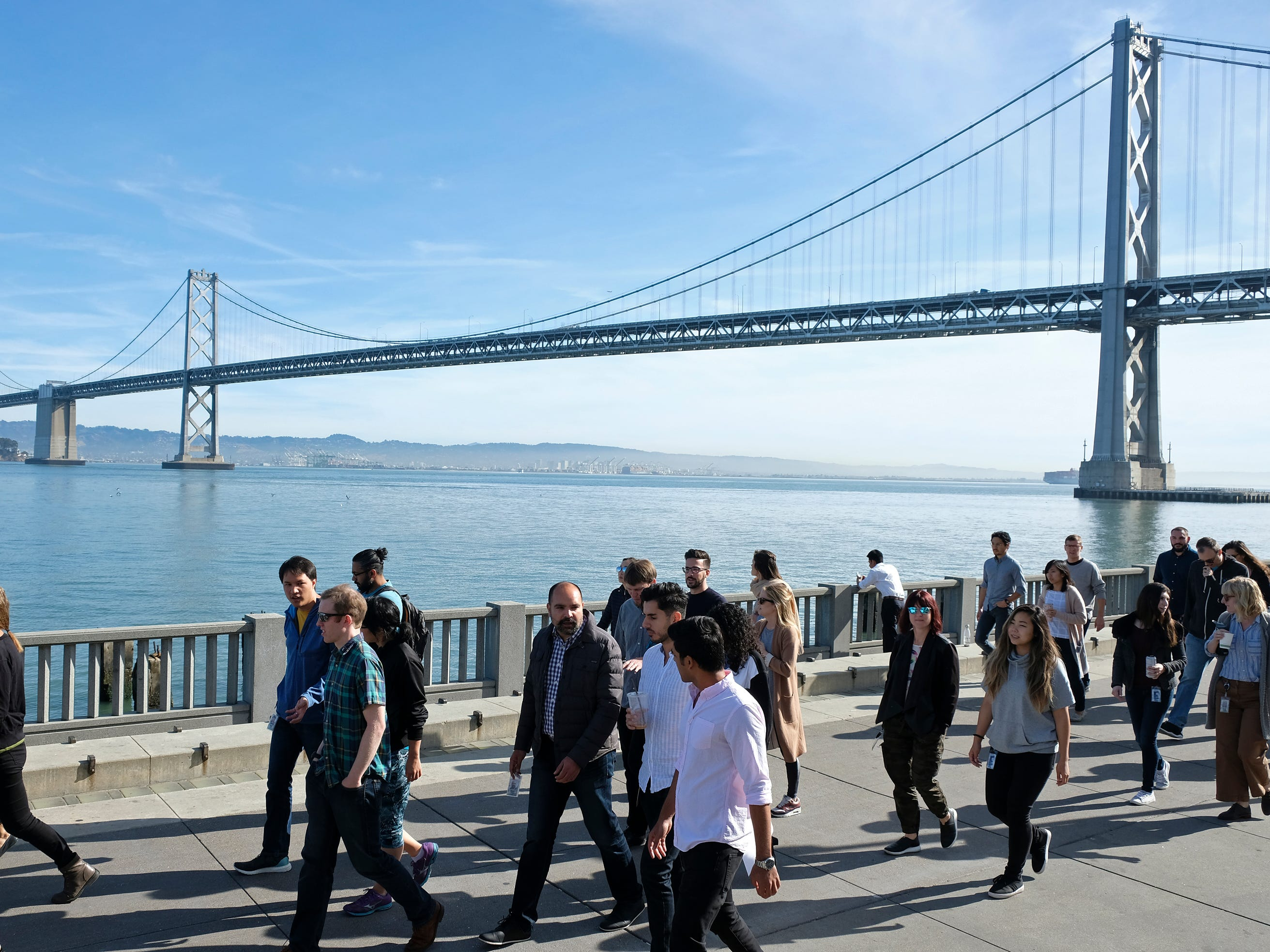 Google employees march along the Embarcadero with the San Francisco-Oakland Bay Bridge in the background during a walkout on Nov. 1, 2018, in San Francisco.